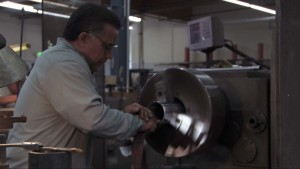 man working inside lathe